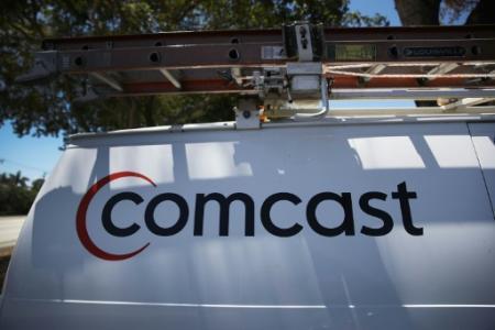 Une rude bataille entre le câblo-opérateur Comcast et le groupe Disney se profilait après que le premier eût lancé à son tour mercredi une offre de rachat sur l'essentiel du groupe de médias et de cinéma Fox (Photo JOE RAEDLE. Getty)