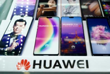 Le chef du renseignement extérieur britannique (MI6) a questionné la participation de Huawei au déploiement de la technologie 5G au Royaume-Uni (Photo Johannes EISELE. AFP)