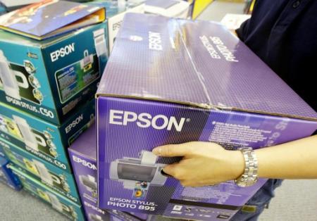 Le fabricant japonais d'imprimantes Epson visé par une enquête préliminaire pour 'obsolescence programmée' (Photo ROSLAN RAHMAN. AFP)